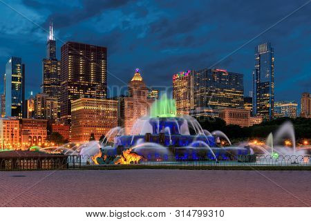 Chicago Skyline Panorama At Night With Skyscrapers And Buckingham Fountain, Chicago, Illinois, Usa.