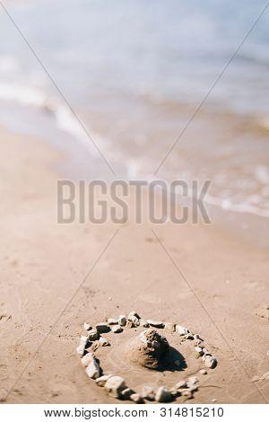 sand castle on the empty beach, tilt-shift lens blur