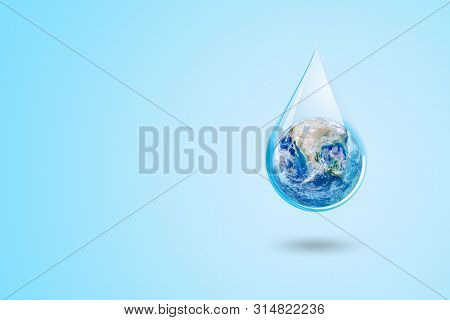 Ecology And Pollution Concept : Blue Planet Earth Globe In Water Drop With Blue Background. (element