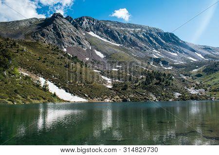 Mountain Lake Estany De Les Truites In Andorra Pyrenees, La Massana, Refugi De Coma Pedrosa