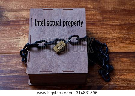 Concept For Copyright, Patent Or Intellectual Property And Idea Protection.box Wrapped With Chain On