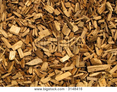 Wood chippings natural brown color abstract background. poster