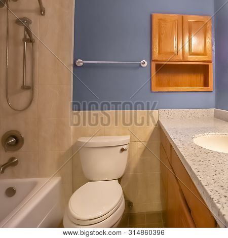 Square Frame Small Bathroom Interior With Vanity Area Adjacent To The Toilet And Bathtub
