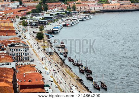 Porto, Portugal: Streets With Pedestrians And Riverboats On River Douro, Cityscape With Red Tile Roo