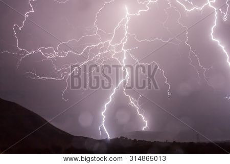 Lightening Thunderstorm In Clear Areas/ Reaching Ground Level/ Red And Pink Lightening