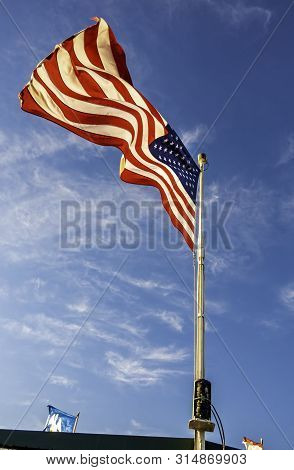 New Orleans, Usa - Dec 11, 2017: An American Flag Flying Proudly In The Wind Onboard The Historic St