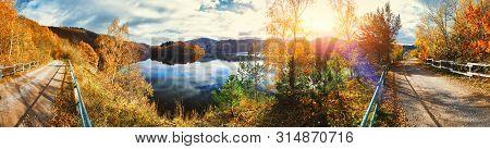 Panoramic Autumn Landscape With Spectacular Sunset Over River. Nature Background