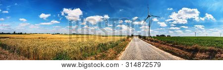Panoramic Summer Landscape With Country Road And Wind Turbines. Ecology Background