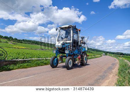 France Lyon 2019-06-20 Winemaking Equipment, Vineyard Harvesting Machine, Blue Tractor Faupin Bobard