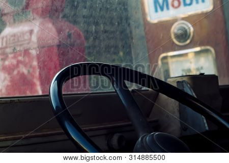 Interior Of Classic Vintage Car -parked Vintage Gas Station. Interior Of An Old Automobile With Stee