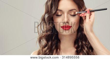 Makeup Artist Applies  Eye Shadow  . Beautiful Woman Face. Hand Of Visagiste, Painting  Cosmetics Of