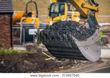 A Digger And Dump Truck Move Dirt To Make Room For The Foundations Of The New Waverley School In She