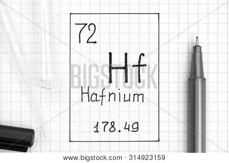 The Periodic table of elements. Handwriting chemical element Hafnium Hf with black pen, test tube and pipette. Close-up. poster