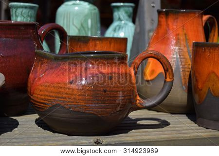 The Pot Is Made Of Clay In Ancient, Vintage Style. Ware Is Homemade. Ware Has Bright Coloring.