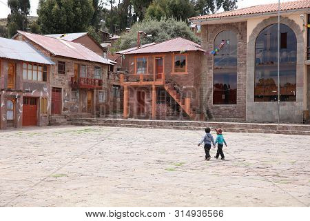 Puno, Peru - October 24, 2018: Unidentified Children On Taquile Island. Its Located On Lake Titicaca