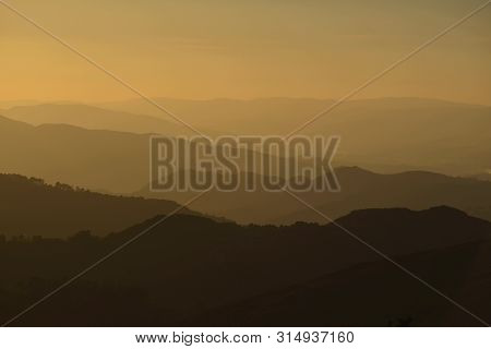Sunset; Hills Silhouettes In The Evening , Geres , Portugal