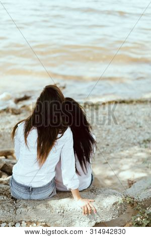 real young lesbian couple in romance near the lake