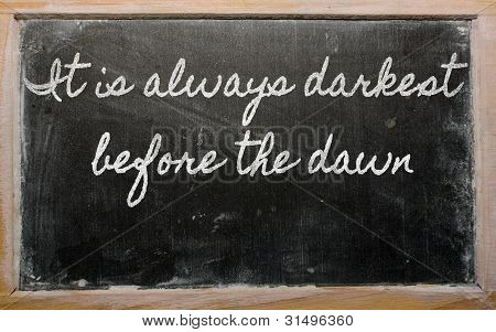 Expression -  It Is Always Darkest Before The Dawn - Written On A School Blackboard With Chalk