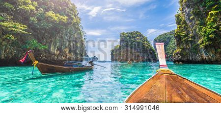 Landscape With  Longtail Boat On Loh Samah Bay, Phi Phi Island, Thailand