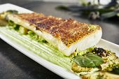 Beautiful Restaurant Plate of Baked Halibut Fillet and Broccoli in Different Textures  Close Up. Exquisite Italian Dish of Grilled Flatfish or Sole Fish on Natural Black Stone, Leaves Background poster