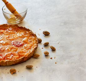 Still Life With Homemade Apricot Tart, Apricot Pits And Dish With Jam And Brush.