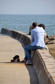 A Young Couple In Sweet Loving Effusions In Front Of The Sea Of Anzio
