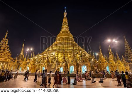 Yangon, Myanmar - Dec. 2, 2019 : View Of Famous Burmese Temple And Popular Place To Visit At  Shweda