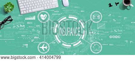 Insurance Concept With A Computer Keyboard And A Mouse