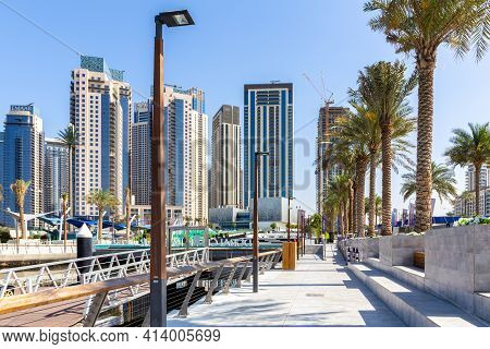 Dubai, Uae, 22.02.2021. Dubai Creek Marina Promenade, With Dubai Creek Harbour Skyscrapers In The Ba