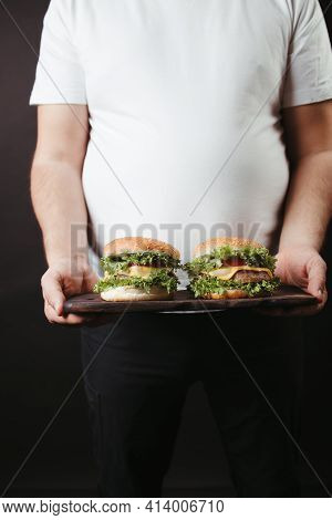 Obese Man With Two Tasty Fattening Hamburgers