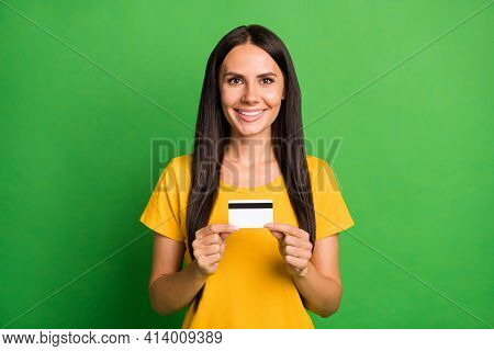 Photo Of Lovely Happy Young Girl Hold Debit Card Salary Spend Good Mood Isolated On Green Color Back