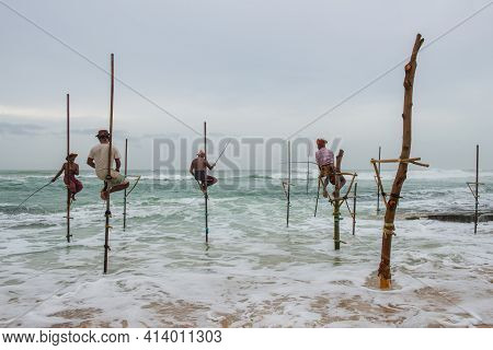Koggala - Sri Lanka : 09-august-2019 : Group Of Local Fisherman Doing Stilt Fishing On The Beach. Th