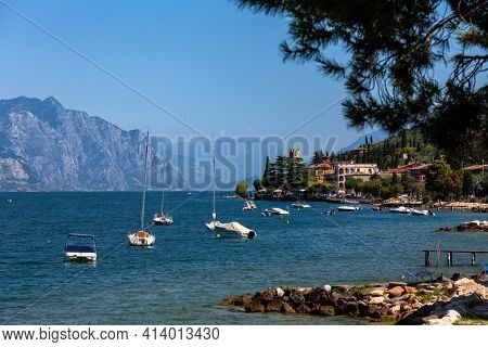 Pleasure boats moored near resort town on the eastern shore of Lake Garda in Northern Italy. Lake Garda is the largest lake in Italy and a popular holiday location on the edge of the Dolomites