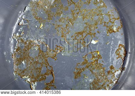 Gray Non-stick Surface Of A Frying Pan With Burnt Fried Eggs Close-up, Kitchen Utensils For Cooking