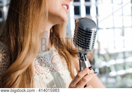 Singer In Front Of A Microphone. Glamour Model Singer. Karaoke Song.