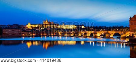 View of Charles Bridge Karluv most and Prague Castle Prazsky hrad in twilight. Panorama