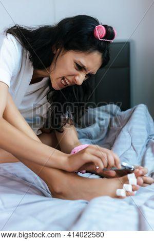 Beauty Young Woman Use Nail Clipper Cut Toenail And Trim Cuticle On Bed Beautiful Caucasian Girl Sho
