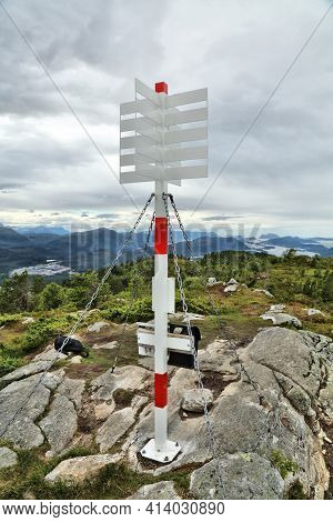 Trig Marker On Nihusen Mountain In Skodje, Norway. Trigonometric Point For Geodetic Surveying.