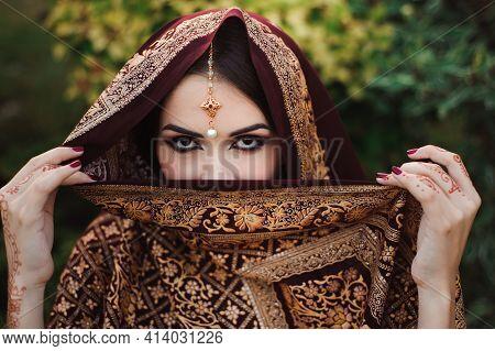 Portrait Of Beautiful Indian Girl . Hindu Woman Model With Tatoo Mehndi And Kundan Jewelry.