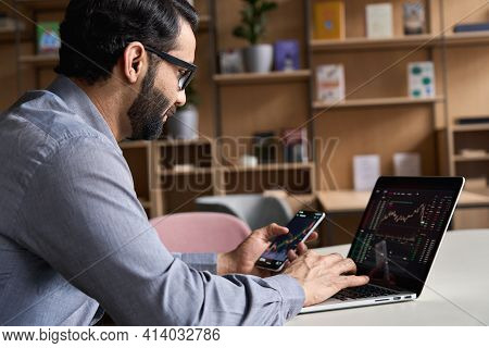 Indian Latin Business Man Trader Investor Analyst Looking At Financial Stock Market Charts Rate Dyna