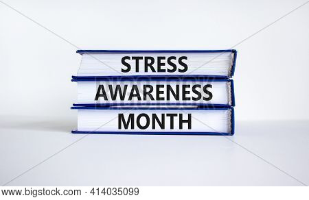 Stress Awareness Month Symbol. Books With Words 'stress Awareness Month'. Beautiful White Background