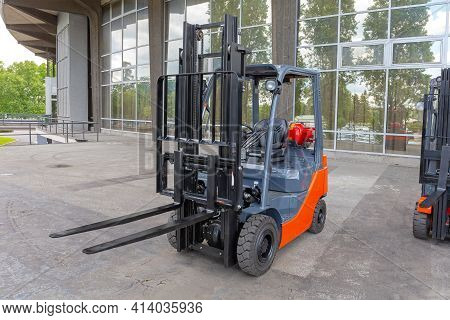 Gas Powered Forklift Tuck In Front Of Building