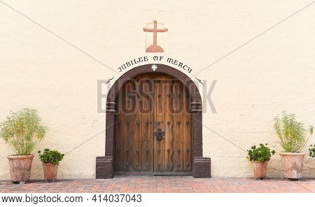 SOLVANG, CALIFORNIA - SEPTEMBER 21, 2016: Mission Santa Ines door closeup. Founded on September 17, 1804,  today it serves as a museum as well as a parish church of the Archdiocese of Los Angeles.