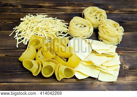 Assorted Or Set Of Italian Pasta On A Wooden Background. Lifestyle, Rustic Style