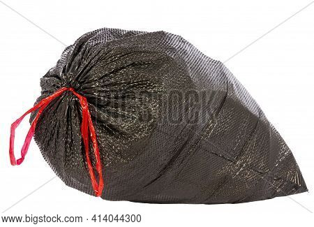 Horizontal Shot Of An Overstuffed Garbage Bag Isolated On White With Copy Space.