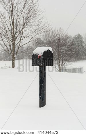 Vertical Shot Of A Snowy Mailbox With Copy Space