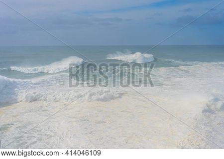 Waves In Atlantic Ocean In The Mist. Nazare, Portugal