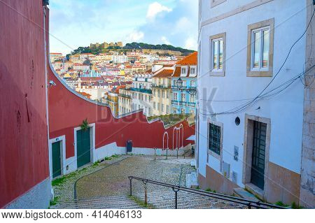 Empty Stairs Down The Street And Skyline Of Lisbon Old Town With Lisbon Castle On A Top Of A Hill. P