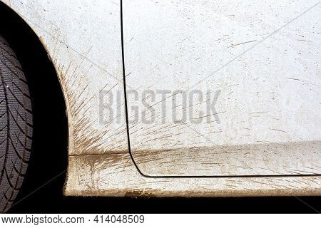 White Dirty Car In The Splash Of The Slurry The Driver Door And The Front Fender Of The Vehicle Clos