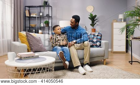 African American Cute Little Boy Child Speaking With Caring Dad In Good Mood Telling How Was His Day